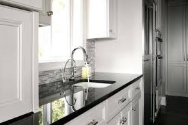 gray and white granite highly polished black pearl granite steel gray granite countertops with white cabinets