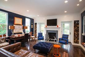 blue accent walls family room contemporary with tv over fireplace white shade