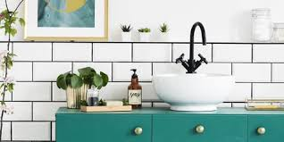 Cute minimalist bathroom design ideas Modern Minimalist Pink Flowers Next To Green Cabinet In Bathroom Interior With Posters And Round Mirrors Real Katarzynabialasiewiczgetty Images Australianwildorg 22 Small Bathroom Storage Ideas Wall Storage Solutions And Shelves