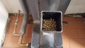 rocket stove gravity fed pellet burner heats a 300 ltr water tank