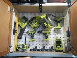 diy wood tool cabinet. reuse an old cabinet and add pegboard to store tools. diy wood tool