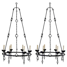 pair of italian wrought iron six light chandeliers circa 1900