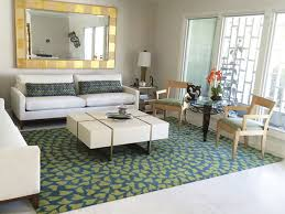 modern apartment living is made simple with this marigold turquoise and green custom area rug this transitional design can be made to order in any size you