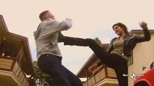 A man fights a woman