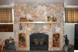 rock fireplace rustic living room with stacked stone wall woodland direct boxwood fireplace mantel shelf river stone fireplace remodel cost