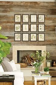decoration inspiring hanging pictures on wall above fireplace design for living room with indoor garden