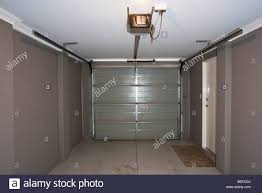 the inside of a garage with an automatic garage door
