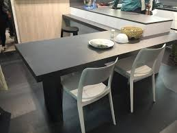 white chairs for a black bar height table view in gallery