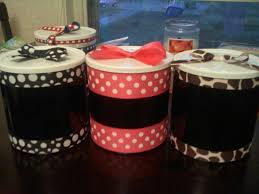 reusing baby formula container just add spray paint and ribbon and you have
