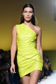 bella hadid wore a florescent green leather dress during versace ss19 show in milan and