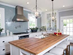 blue glas subway tile backsplash ideas for kitchen decoration with white cabinet and island using wooden countertops