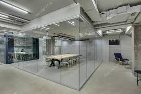 loft style office. Conference Zone In The Office A Loft Style With Brick Walls And Concrete Columns. Has Wooden Table Gray Chairs Glass Walls. T