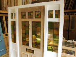 stained glass front door with frame and sidelights