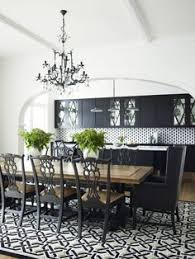 greg natale chic black and white open plan dining room with black trestle based dining table and by emel