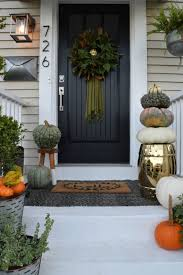 fall front porch decor rich colors and all the pumpkins
