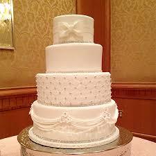 Luxe-Wedding-Cake-quilted-pattern-fondant-drapes-fondant-bow-Sweet ... & Luxe wedding cake with quilted pattern Adamdwight.com
