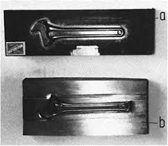 forging dies. figure 7.3: cold hubbed cavity in a drop forging die, a) hub, b) dies