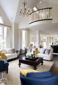 This living room is delicately touched up with white walls stretching along  the second level and