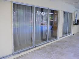old 1960 s sliding glass doors installed outside of tie beam in non structural plywood stucco pockets