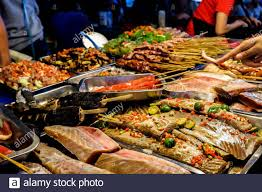 Different Seafood and Meat Choices at the Night Market Stock Photo - Alamy