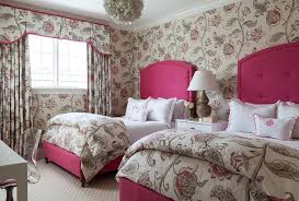 red and gray girls bedroom features walls clad in red and gray fl wallpaper lined with a pair of red tufted headboards on full beds dressed in white
