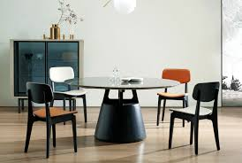 the unity dining table is our largest round table yet available in 74 or 86 with such a large diameter reaching the middle would be difficult