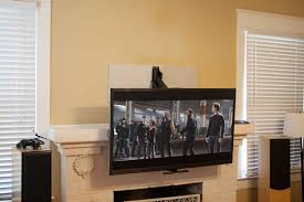 mantelmount fireplace tv mount lowered