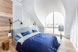 white modern master bedroom. This Modern Attic Bedroom Is Decorated In Natural Wood And White Master I