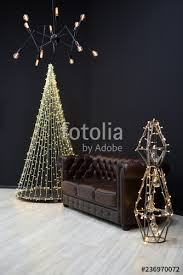 new year s loft style decor against a black wall a tree from a