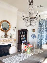 french empire chandelier in french country dining room