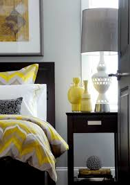 View in gallery Gray and yellow bedroom with vintage black and white  photograph on the walls [Design:
