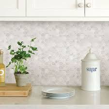 picture of hexagon marble l and stick backsplash