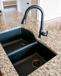 black granite composite sink with kohler oil rubbed bronze faucet and drain so