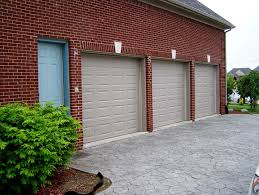 before faux painting look at how boring the garage doors are