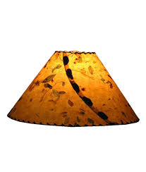 handmade paper lamp shades with natural ons and leather lacing from rustic artistry