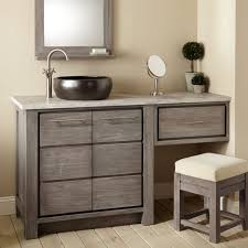 bathroom blackvessel sink vanity with grey wooden makeup cabinet with several drawer added small bench