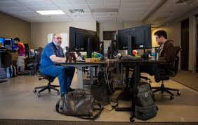 Architect Yo Sub Kwon, from left, Senior Engineer Adam Englander and  Android Developer Armando Smith, work at their desks at LaunchKey, a Las  Vegas-based technology company that was recently acqui …  