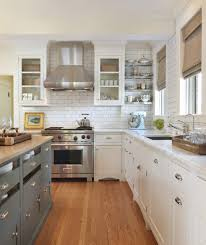 {Kitchens} Subway Tiled Walls & Two-Toned Cabinets. Taste Interior Design