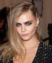 cara delevingne punk style spike earrings smokey eyes neutral lips side hair at the metgala metropolitan museum of art 2016
