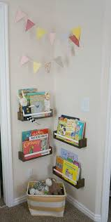 sweet book corner in a neutral plus modern pastels shared room for sisters