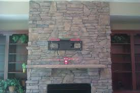 how to mount a tv above stacked stone fireplace ideas
