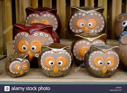 ceramic garden ornaments ceramic garden ornaments in the shape of cross eyed owls stock