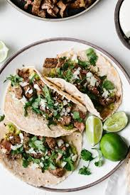 these delicious carne asada tacos are made with grilled skirt steak avocado cotija cheese