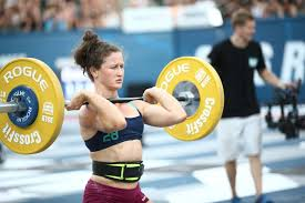 gladstone athlete tia clair toomey lifting a set of weights