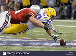 LSU Tigers Kirston Pittman and Ohio State Buckeyes Kirk Barton dive for a  fumble by Ohio State's quarterback Todd Boeckman during the fourth quarter  of the NCAA BCS National Championship football game