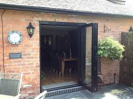 folding patio door bi fold patio door with black aluminum frame for country house folding glass patio door s
