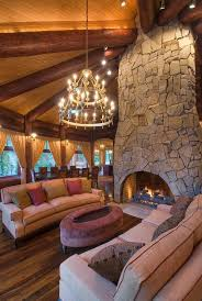 log cabin great room love the fireplace and round design
