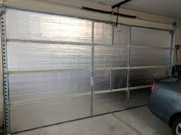 insulating your garage door is an easy diy job if you re up for it