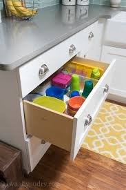 use large pull out drawers to organize kids plates bowls and cups so they can how to organize kitchen cabinets