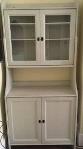 ikea light grey display cabinet with glass panel doors